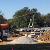 Pouring concrete for the sidewalks through the Pedestrian Gateway