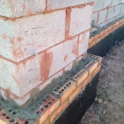 Close-up of the first two layers of brick on Pedestrian Gateway